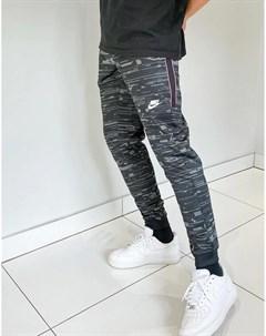 Черные джоггеры с манжетами логотипом и сплошным принтом Nike Concrete Jungle Pack Nike sb