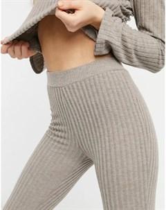 Бежевые расклешенные брюки в рубчик от комплекта Pimkie