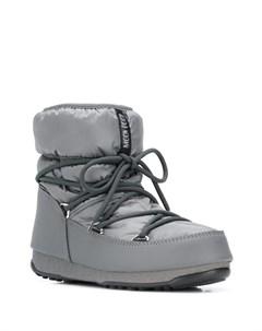 Дутые ботинки на шнуровке Moon boot