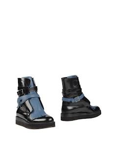 Полусапоги и высокие ботинки Casamadre