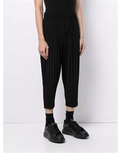 Плиссированные зауженные брюки Homme plissé issey miyake