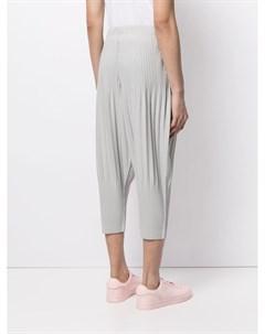 Зауженные плиссированные брюки Homme plissé issey miyake