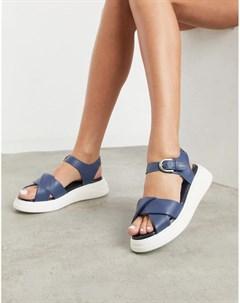 Темно синие кожаные сандалии на массивной подошве nora Fiorelli