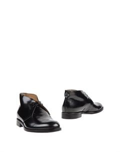 Полусапоги и высокие ботинки Sutor mantellassi