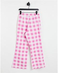 Расклешенные брюки в клетку с оборками на карманах от комплекта Neon rose