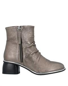 Полусапоги и высокие ботинки Oasi
