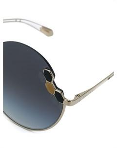 Солнцезащитные очки в круглой оправе Bulgari