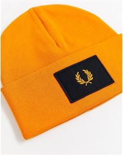 Оранжевая шапка бини с логотипом Fred perry