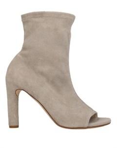 Полусапоги и высокие ботинки Del carlo