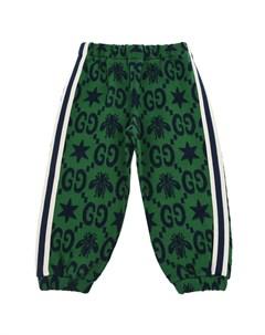 Зеленые спортивные брюки с лампасами Gucci