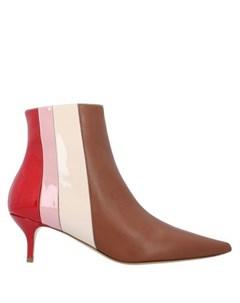 Полусапоги и высокие ботинки Delpozo