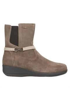 Полусапоги и высокие ботинки Swissies