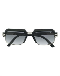 Солнцезащитные очки в массивной оправе Cazal