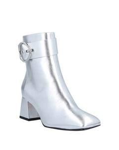 Полусапоги и высокие ботинки Salar