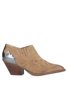 Полусапоги и высокие ботинки Makris