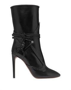 Полусапоги и высокие ботинки Alaia