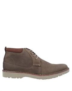 Полусапоги и высокие ботинки Clarks