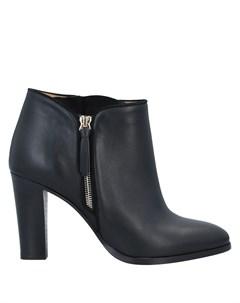 Полусапоги и высокие ботинки Sézane